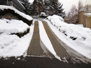 heated tire tracks on steep driveway