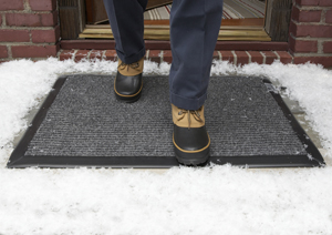 WarmQuest's Radiant Trak product melting snow from under the doormat.